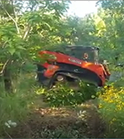 Clearing overgrown land, removing scrub, brush, trees with mulcher. Bell Brush Busters Sulphur Springs, north, and northeast Texas